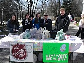 Good Kin Sue and Good Kin Lisa with some helpers at the donations table